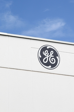 Saint Priest, France - July 29, 2017: General Electric logo on a wall. General Electric is an American multinational conglomerate corporation headquartered in Boston, USA