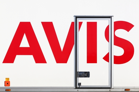 Tirstrup, Denmark - February 8, 2018: Avis logo on a truck. Avis is an American car rental company headquartered in New Jersey, United States Editorial