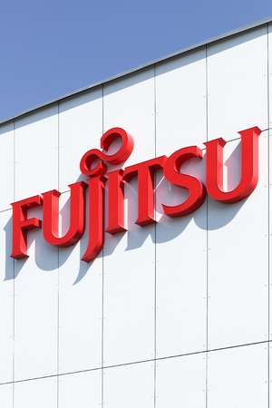 Aarhus, Denmark - August 22, 2015: Fujitsu on a wall. Fujitsu is a Japanese multinational information technology equipment and services company headquartered in Tokyo, Japan Publikacyjne