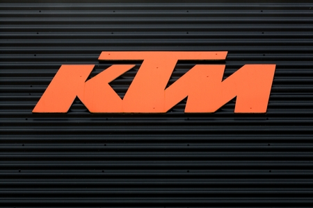 Torsted, Denmark - April  1, 2018: KTM on a wall. KTM is an Austrian motorcycle and sports car manufacturer owned by KTM Industries AG and Indian manufacturer Bajaj Auto