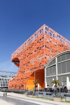 Lyon, France - March15, 2017: The orange cube building at Confluence harbor in Lyon, France Redakční