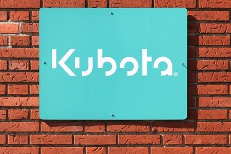 Horsens, Denmark - April 2, 2018: Kubota on a wall. Kubota is a tractor and heavy equipment manufacturer based in Osaka, Japan