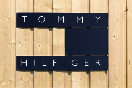 Villefranche, France - June 11, 2017: Tommy Hilfiger on a wall. Tommy Hilfiger is an American multinational that designs and manufactures upper market apparel for men, women and children
