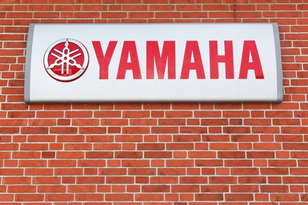 Skanderborg, Denmark - April 22, 2018: Yamaha on a wall. Yamaha is a Japanese multinational corporation with a wide range of products like musical instruments, electronics and motorcycles