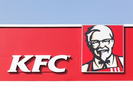 Tilst, Denmark - April 20, 2086: KFC on a facade. KFC is a fast food restaurant chain that specializes in fried chicken and is headquartered in Louisville, Kentucky, in the United States Editorial