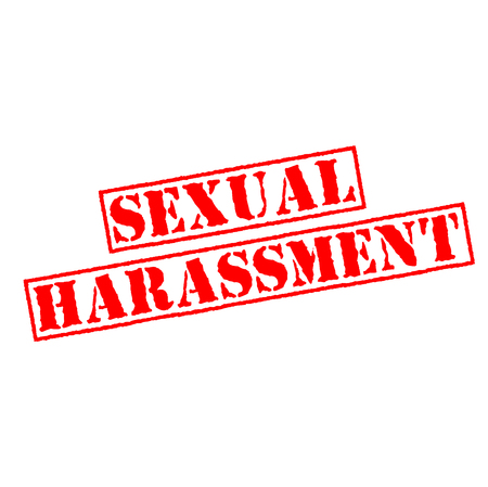 Rubber stamp with text sexual harassment