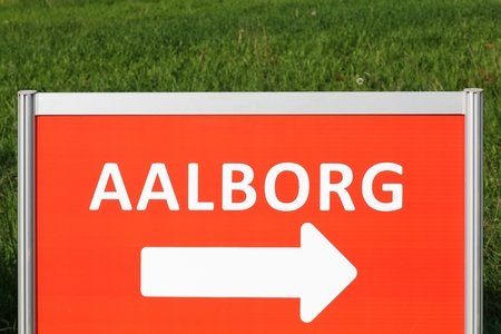 Road sign with Aalborg city direction in Denmark Stock Photo