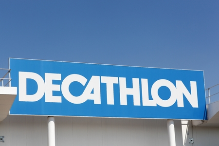 Limonest, France - July 19, 2018: Decathlon sign on a wall. Decathlon is a french company and one of the worlds largest sporting goods retailers