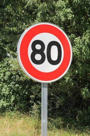 Speed limit traffic sign 80 on the road in France Reklamní fotografie