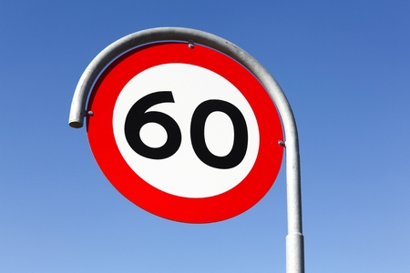 Speed limit traffic sign 60 on the road Stock Photo