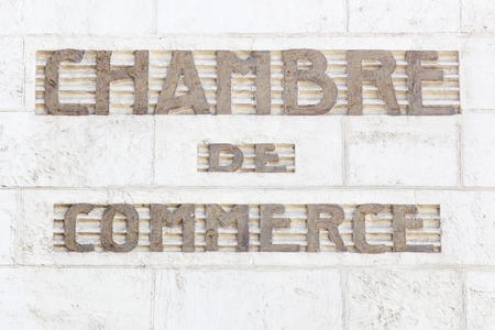 Chamber of commerce sign in French on a wall Stock Photo