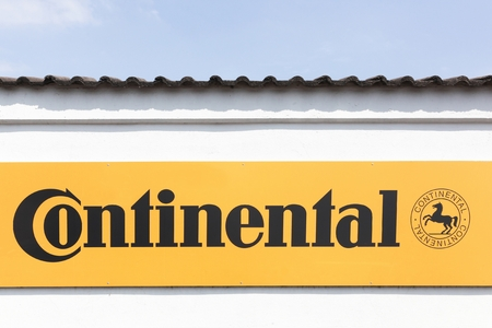 Munster, Germany - July 22, 2018: Continental sign on a wall. Continental based in Hanover, is a leading german automotive manufacturing company specialising in tires and brake systems Editöryel