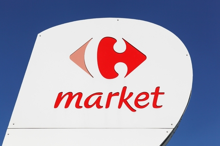 Belleville, France - June 27, 2018: Carrefour market sign on a panel. Carrefour is a french multinational retailer headquartered in France and it is one of the largest hypermarket chains in the world