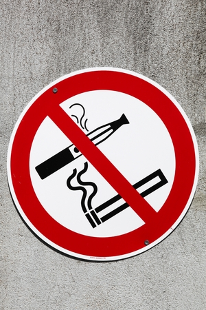 Sign no smoking cigarette and e cigarette on an industrial site