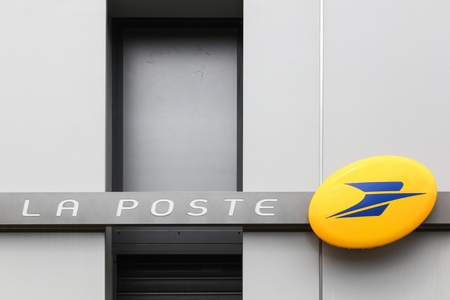 Lyon, France - May 26, 2018: Facade of La Poste in France. La Poste is a postal service company in France, operating in metropolitan France as well as in the five French overseas departments