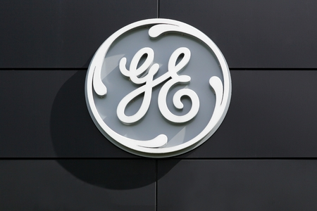 Fredericia, Denmark - April 21, 2018: General Electric compagny logo on a wall. General Electric Company is an American multinational conglomerate headquartered in Boston