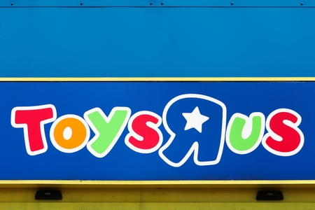 Tilst, Denmark - May 10, 2018: Logo of the brand Toys r us on a wall. Toys r us is an American toy and juvenile products retailer