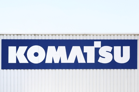 Saint Priest, France - September 8, 2018: Komatsu logo on a wall. Komatsu is a Japanese multinational corporation that manufactures construction, mining, and military equipment