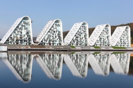 Vejle, Denmark - October 12, 2018: Vejle waterfront in Denmark with wave residential building called bolgen in Danish