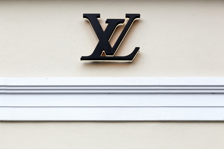Copenhagen, Denmark, October 21, 2018: Louis Vuitton sign on a wall. Louis Vuitton is a French company specialized in fashion accessories