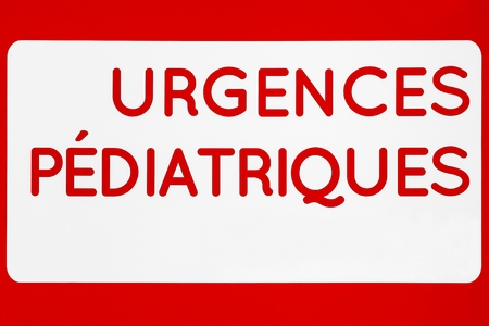Pediatrics emergency sign on a wall called urgences pediatriques in French, France 写真素材