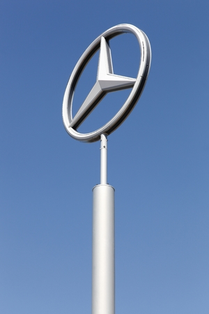 Nimes, France - July 1, 2018: Mercedes logo on a pole. Mercedes-Benz is a german automobile manufacturer, a multinational division of the german manufacturer Daimler AG