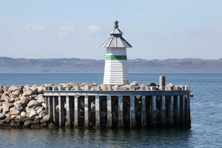 Harbor and lighthouse of Ebeltoft in Denmark Imagens