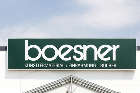 Munster, Germany - July 22, 2018: Boesner logo on a wall. Boesner is a wholesaler and retailer of professional artist materials, framing and art books