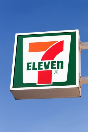 Copenhagen, Denmark - April 2, 2019: 7 eleven logo on a wall. 7-Eleven is an international chain of convenience stores that operates primarily as a franchise