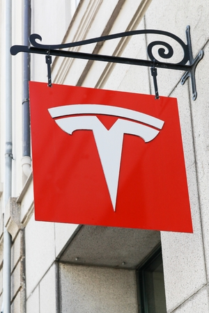 Copenhagen, Denmark - Avril 15, 2019: Tesla logo on a wall. Tesla is an American automotive and energy storage company that designs, manufactures, and sells luxury electric cars Editorial