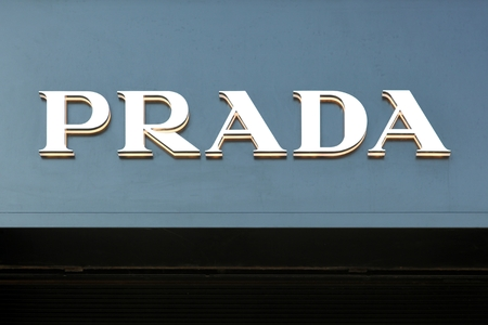 Copenhagen, Denmark, April 2, 2019: Prada logo  on a wall. Prada is an Italian luxury fashion house, specializing in leather handbags, travel accessories, shoes, ready-to-wear and perfumes