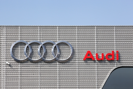 Nimes, France - July 1, 2018: Audi logo on a building of a dealership. Audi is a German automobile manufacturer that designs, engineers, produces, markets and distributes luxury vehicles