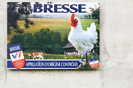 Vonnas, France - May 22, 2018: Advertisement for the famous Bresse chicken on a wall. The Bresse is a French chicken product which has appellation dorigine controlee status 報道画像
