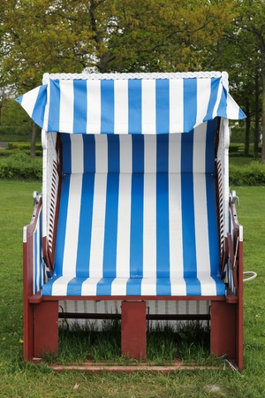 Strandkorb or beach-chair in Denmark Imagens