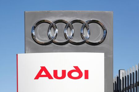 Risskov, Denmark - May 11, 2019:  Audi logo on a wall. Audi is a German automobile manufacturer that designs, engineers, produces, markets and distributes luxury automobiles