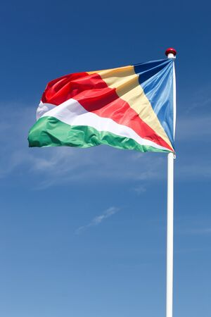 Flag of Seychelles waving in the sky