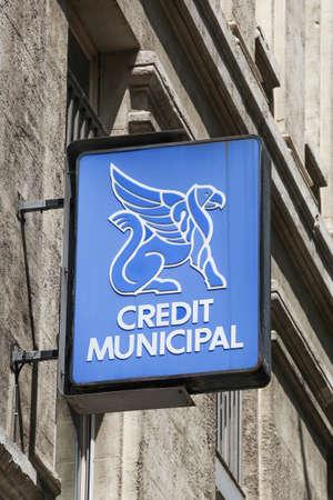 Lyon, France - June 28, 2020: Credit municipal logo on a wall. In France, credit municipal are both municipal public establishments and banking enterprises which have a monopoly on pawn shops