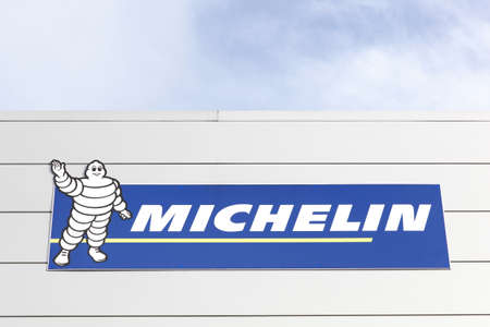 Macon, France - January 30, 2016: Michelin logo on a wall. Michelin is a tire manufacturer based in Clermont-Ferrand in France and it's one of the three largest tire manufacturers in the world