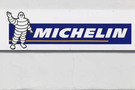 Munster, Germany - July 22, 2018: Michelin logo on a wall. Michelin is a tire manufacturer based in Clermont-Ferrand in France and it's one of the three largest tire manufacturers in the world