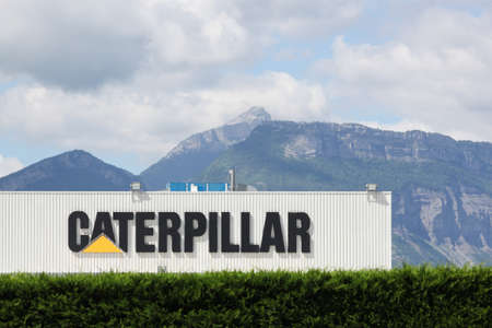 Grenoble, France - June 16, 2019: Caterpillar manufacturing plant. Caterpillar is an American corporation which designs, develops, engineers, manufactures, markets and sells machinery, engines Éditoriale