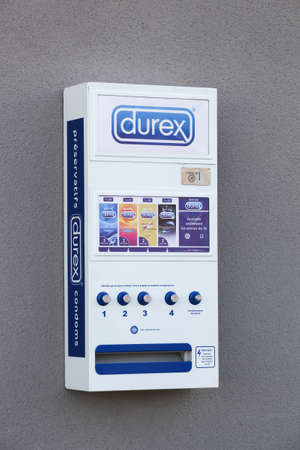 Belleville, France - August 23, 2020: Durex condoms automat on a wall in France. Durex is a registered trademark name for a range of condoms originally developed and produced in the United Kingdom