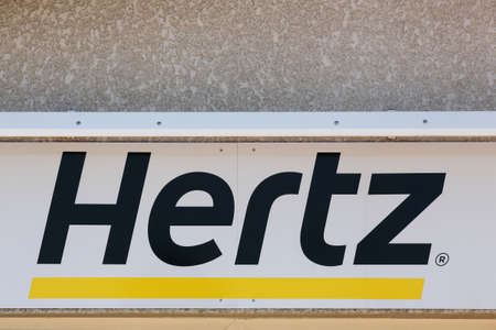 Roanne, France - May 31, 2020: Hertz logo on a wall. Hertz is an American car rental company with international locations in 145 countries worldwide
