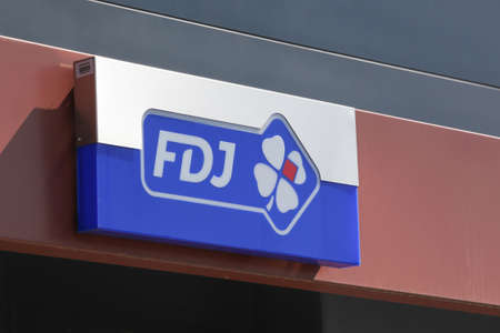 Saint-Priest, France - September 8, 2018: FDJ logo on a wall. Francaise des Jeux also called FDJ is the operator of national lottery games in France