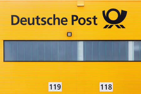 Kamen, Germany - July 22, 2018: German post warehouse called Deutsche Post in German. Deutsche Post operating under the trade name Deutsche Post DHL, is a German courier company