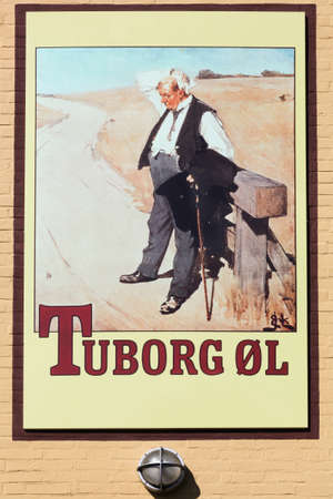 Aarhus, Denmark - May 12, 2019: Vintage Tuborg beer advertising on a wall. Tuborg is a Danish brewing company founded in 1873 on a harbor in Hellerup, Denmark Éditoriale