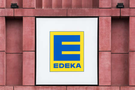 Berlin, Germany - July 12, 2020: Edeka logo on a wall. The Edeka Group is the largest German supermarket corporation Éditoriale