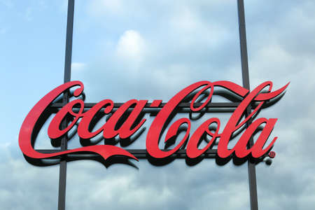Berlin, Germany - July 11, 2020: Coca cola logo on a wall. Coca-Cola is a carbonated soft drink. It is produced by The Coca-Cola Company of Atlanta, Georgia, and is often referred to simply as Coke