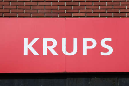 Tournus, France - July 5, 2020: Krups logo on a wall. Krups is a German kitchen appliance manufacturer. It is part of the group SEB