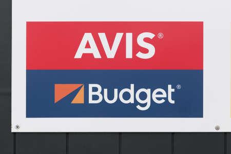 Billund, Denmark - February 20, 2019: Avis Budget logo on a wall. Avis Budget Group is the American parent company of Avis car rental, Budget car rental, Budget truck rental, and Zipcar