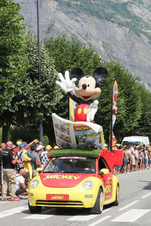 Saint Jean de Maurienne, France - July 24, 2015: Le Journal de Mickey car during the passing of the publicity caravan on the road to La Toussuire during Le Tour de France on July